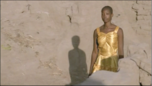 (43:03) The most memorable moment for me in the film is this woman's gold dress.